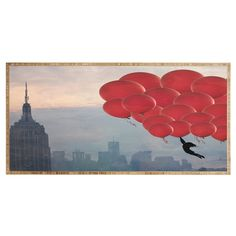 Maybe Sparrow Photography Floating Over The City Desk | DENY Designs Home Accessories #DENYWishList