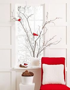 "Gather bare branches from the garden, and arrange them in a narrow glass vase filled with artificial snow. More ""snow"" (cotton tufts) drifts on branches. Cardinals alight as if to gather the bright berries that we cut from faux sprays and wired on. Give the birds another landing spot with a nest on the sill."