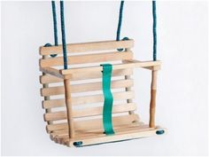 2 bent metal poles. However many planks of sanded wood needed 2 long pieces of tough rope 1 strap of thick ribbon  Easy peasy homemade swing for toddlers !