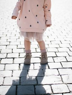 pink sweatshirt, pink tutu, and boots - cute outfit for a girl