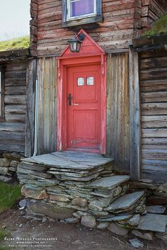 "Old Red Door in Roeros, Norway - Photo by Aslak Tronrud ""Stairs & Porch look good with the wood! ""The red has faded on the door which brings it all together ""Weathered Look"" Cool Doors, Unique Doors, Door Knockers, Door Knobs, Porches, When One Door Closes, Door Gate, Windows And Doors, Red Doors"