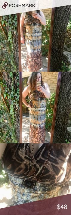 •Leopard Maxi Dress• Gorgeous dress that is perfect for any occasion. It has lots of stretch & is super soft. Has tie to cinch the waist. Pair with sky high heels to complete this look. NF Dresses Maxi