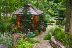 Japanese style teahouse hidden in a back corner of a garden makes for an ideal retreat.