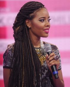 Angela Simmons rocks a braided style with subtle highlights.