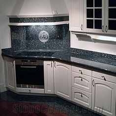 Blue Pearl Granite Counter With White Subway Tile