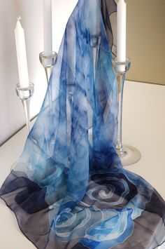 Elegant hand-painted silk scarf.
