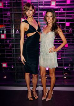 Strike a pose! Karlie Kloss and Alessandra Ambrosio smile at the Victoria's Secret event in LA last night.