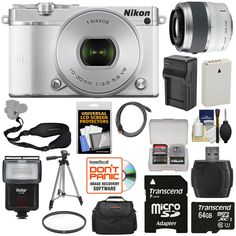 Nikon 1 J5 Wi-Fi Digital Camera & 10-30mm Lens (White) with 30-110mm VR Zoom Lens + 64GB Card + Battery + Charger + Strap + Case + Tripod + Flash + Filter Kit. KIT INCLUDES 16 PRODUCTS -- All BRAND NEW Items with all Manufacturer-supplied Accessories + Full USA Warranties:. [1] Nikon 1 J5 Wi-Fi Digital Camera & 10-30mm Lens (White) + [2] Nikon 1 30-110mm VR Lens + [3] PD-C20 Digital Camera Case + [4] Transcend 64GB microSDXC Card +. [5] Spare EN-EL24 Battery + [6] Battery Charger + [7]...