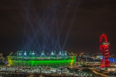 Searchlights over the Olympic Stadium during the opening ceremony of the 2012 London Olympic Games on July 27, 2012