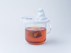 Cute Polar Bear 'Fishes' For Tea Bag, Holds It In Place While Keeping Tea Warm