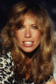 Carly Simon, golden tones/grown out look, 1970's