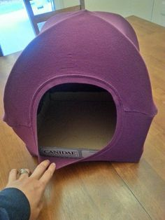 cat tent with t-shirt 2 wire hangers and the card board case from canned cat…