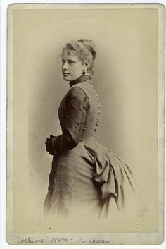 [Woman in dress showing her back, Brooklyn, New York, 1880s.]