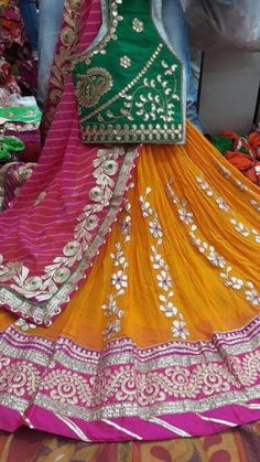 Pure Georgette lehengas Pure Georgette lehangas with heavy bandhani dupatta and gota border Bandhani silk dupatta With gotawork banglori silk unstitched blouse Size fits upto 40 Rajasthani Lehenga, Pakistani Mehndi Dress, Bridal Mehndi Dresses, Indian Gowns Dresses, Indian Fashion Dresses, Indian Designer Outfits, Bridal Outfits, Pakistani Dresses, Indian Outfits