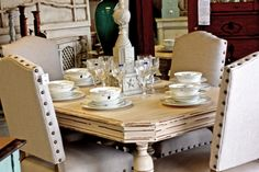 this a a very chic duncan phyfe table that we have re-finished, with some heavy studded parson chairs