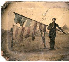 Portrait of Soldier with American battle flag, ca. 1861 :: Civil War Narratives