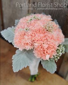 Peach 'Lizzy' carnations, accented with tucks of baby's breath and wrapped in lamb's ear. Designed by Meredith Cope PortlandFloristShop.com