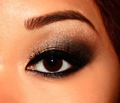 Shimmery smoky eye makeup. Bronze peach, pewter, light and dark brown and black (for Asian, monolids or hooded eyelids)...