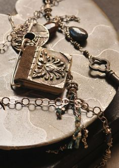Leather Bound Journal Pendant by Christi Anderson Elemental Adornments on Etsy. $325