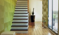 Movida wallpaper and concrete stairs with black treads. Love the focal point plant in the black pot