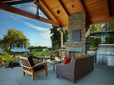 This stunning waterfront outdoor living area was completed by Toth Construction. #luxePNW