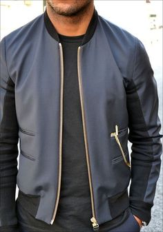 Two-tone black men's leather jacket with brass zipper.