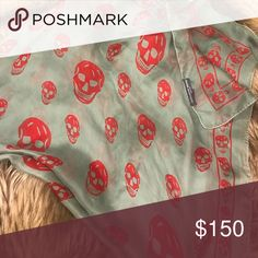 """Alexander McQueen skull scarf Chiffon scarf featuring the iconic red repeat skull print with a skull border and Alexander McQueen logo, on aqua/green chiffon with rolled edges. This scarf is clean and beautiful throughout. Slightly used a handful of times. 100% silk. Measurements: 40 x 45"""" made in Italy. 100% authentic purchased at Saks Alexander McQueen Accessories Scarves & Wraps"""
