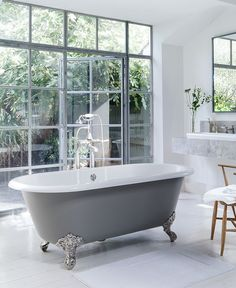 The elegant and traditional Cheshire freestanding bath against stunning windows.