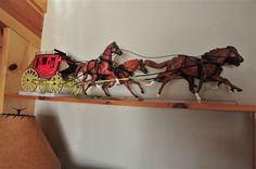 Breyer model horses hauling a kit-built stagecoach. The tack is all hand-made by the coach's owner, who also built the coach.