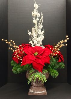 Holiday 2014 Season Faux red poinsettia, gold berries and frosted birch branches on pine filled copper urn. Original design and arrangement by http://nfmdesign.synthasite.com/