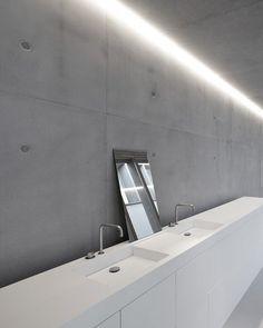 Concrete + white bathroom