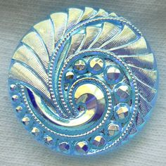 Transparent Czech glass button with aqua feathered paisley motif