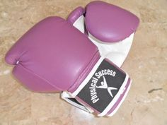 Kids Boxing Gloves, Boxing Gloves for Kids 4oz PURPLE by Physical Success Partners. Save 40 Off!. $23.99. Durable soft vinyl coated Boxing Gloves for kids.    These boxing gloves are a great value for your kids.   Made of Durable foam, soft vinyl coating, inside the gloves a silk lining for comfort. Made with a real boxing glove feel. Designed with a Velcro wrist support to help your child keep a perfect form while learning how to strike a punching bag or sparring with his/her opponen...