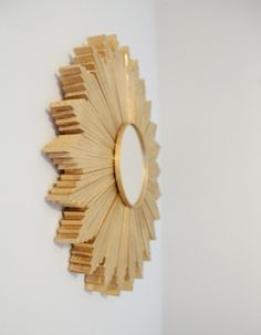 wood shim sunburst mirror. This looks expensive for about $30. Great size for above the bed.