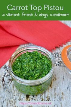 Recipe for carrot top pistou. Don't throw those carrot greens away. This vibrant, fresh & zingy condiment is quick to make and enhances all sorts of foods. Use it as a pasta sauce, spread it on sandwiches, add it to soup or smother cooked vegetables with it. #TinandThyme #CarrotTops #CarrotGreens #CarrotRecipe #pistou #CondimentRecipe #LeftoversRecipe #LoveFoodHateWaste #VeganPesto #VeganRecipe