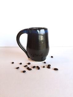A wonderfully made, studio pottery coffee mug.