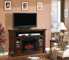 ClassicFlame Belmont TV Stand for TVs up to Caramel Oak (Electric Fireplace Insert sold separately) Fireplace Console, Two Sided Fireplace, Fireplace Inserts, Cozy Fireplace, Modern Fireplace, Living Room With Fireplace, Fireplace Mantels, Fireplace Ideas, Electric Fireplace Entertainment Center