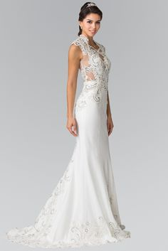 f6efc7215fb Say I do in this sexy wedding dress with sheer illusion cut outs. A mermaid  style informal dress great as a reception dress or vow renewal.