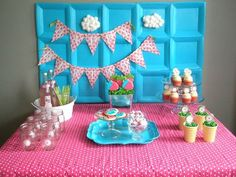 Strawberry themed dessert table with paper plate backdrop