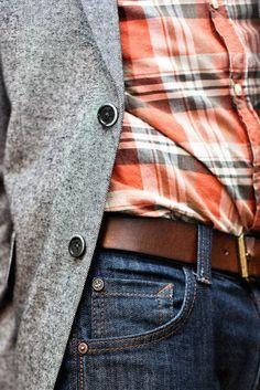 Love the look, dark denim, red/white/dark gray plaid shirt, brown belt and a light gray nubby blazer.