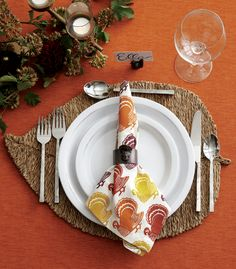 A beautifully set Thanksgiving table sets the stage long before the turkey appears. Set yours early so you're not in a rush when guests arrive—then bask in the compliments. The basics for setting an inviting table are simple: each guest needs a plate, fork, knife and spoon, water glass, wine glass and napkin. From there, the tone of your Thanksgiving table depends entirely on the type of gathering.