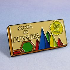 Ben was at it again when he created Cones of Dunshire. This pin is as perfect as his humble farmer. Accountants at Gryzzl are all about the cones. This pin is perfect to add to your Parks and Recreation collection! This pin is red dyed soft enamel, 1.75 wide, 2 Post Rubber backing