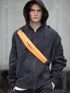 Combining the essential concept of a bag, with that of clothing, we introduce a wearable collection that redefines the lines between wearing and carrying. Simple Bags, Easy Bag, Rain Jacket, Bomber Jacket, World Of Fashion, New Product, Color Splash, Windbreaker, Raincoat
