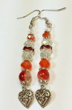Silver Heart Dangle Earrings. Approximately 2 and 1/2 inch long Red and Clear Crystal Beaded earrings with Silver heart dangle charms