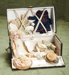 Lot: 9 (23 cm.) German bisque doll by Kuhnlenz in trunk with trousseau 800/1000 | Proxibid Auctions