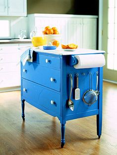 Take an old dresser, paint it up, maybe add a cutting board top or marble, some hooks and shiny knobs. Voila! Kitchen cart.