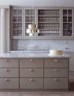 gray-cabinets-brass-hardware-Ilse-Crawford-gold