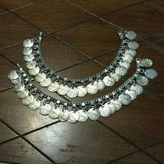 PAIR OF SILVER ANKLETS Silver with coins.  Each 10 inches long Jewelry