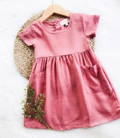 Dusty Rose Linen Button Back Pocket Dress    For your favorite gal are these gorgeous linen blend dresses. With hidden pockets, every girl's favorite, she will love twirling