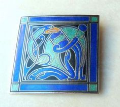 Vintage large, square, celtic book of kells, Tara wear style brooch, formed from cloisonne enamel in a zoomorphic bird design.